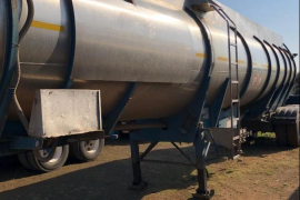 Tank Clinic, Tri- Axle, Stainless Steel Tank Trailer, Used, 1997